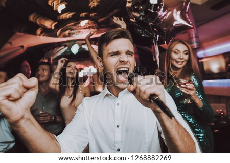 Sing. Men. Microphone.Great Mood. Sing in Karaoke. Karaoke Club. Celebration. Dance Club. Holidays Concept. Dancing People. Young People. Trendy Modern Nightclub. Party Maker. Birthday. Men. Have Fun.