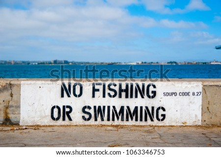 Sing says NO FISHING OR SWIMMING on the port of San Diego, California. California is known with a good wether. This port deals with cargo, fisher man, and passenger ships in United States.