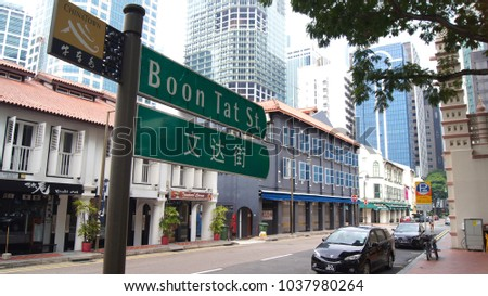SINGAPORE - APR 2nd 2015: Bilingual Street Sign in Singapore Chinatown. Singapore is a multi-racial city where English acts as the common language among different races