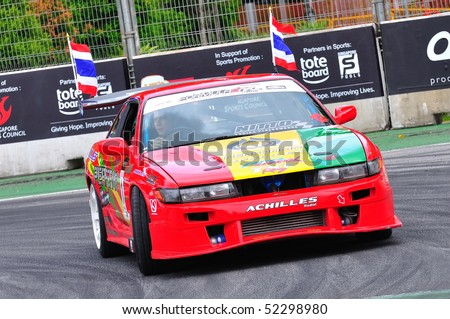 SINGAPORE - APRIL 25: Davide Dorigo from PTT team parading in his Nissan Silvia drift car at Singapore Formula Drift at F1 Pit Building April 25, 2010 in Singapore