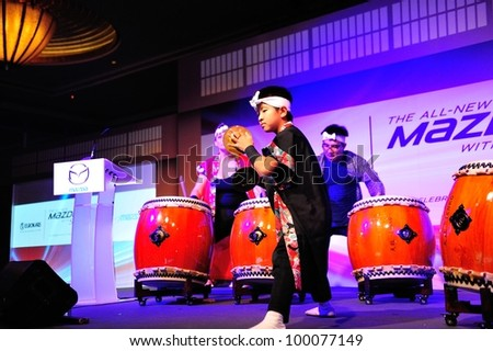 SINGAPORE - APRIL 13: Drum performance during the launch of new Mazda CX-5 crossover SUV April 13, 2012 in Singapore