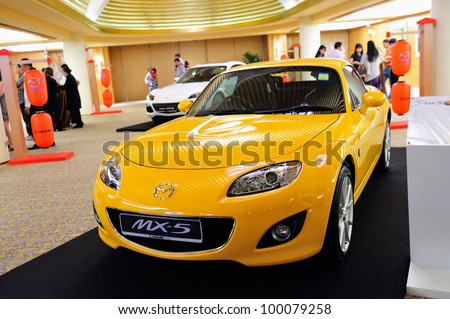 SINGAPORE - APRIL 13: Mazda MX-5 roadster on display at the launch of new Mazda CX-5 crossover SUV April 13, 2012 in Singapore - stock photo