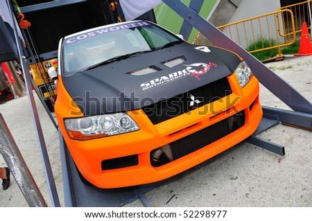SINGAPORE - APRIL 25: Mitsubishi Evo drift car at Singapore Formula Drift at F1 Pit Building April 25, 2010 in Singapore