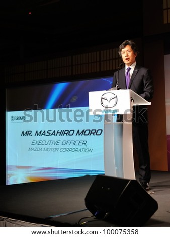 SINGAPORE - APRIL 13: Mr Masahiro Moro (Executive Officer, Mazda Motor Corporation) giving an opening address at the launch of new Mazda CX-5 crossover SUV April 13, 2012 in Singapore