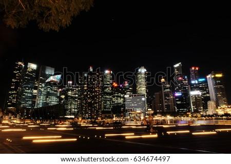 SINGAPORE - April 4, 2017: Night park in the city near Marina Bay Sand