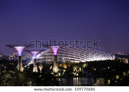 SINGAPORE-AUG 9:A night view of the Supertrees Grove, Cloud Forest & Flower Dome at Gardens by the Bay on Aug 9, 2012 in Singapore. Spanning 101 hectares & five-minute walk from Bayfront MRT Station. - stock photo