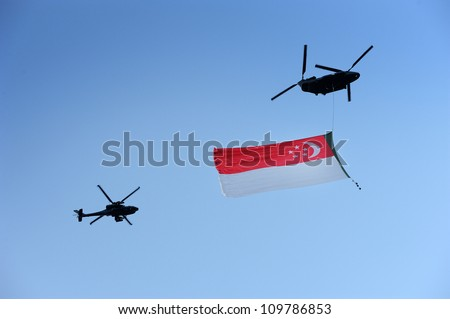 SINGAPORE - AUG 9: Chinook helicopter flying Singapore flag during Singapore National Day Parade (NDP) 2012 on Aug 9, 2012 in Singapore. The theme for NDP 2012 is  Loving Singapore, Our Home.
