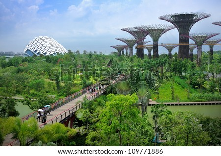 SINGAPORE-AUG 5: Day view of The Supertree Grove, Cloud Forest & Flower Dome at Gardens by the Bay on Aug 5, 2012 in Singapore. Spanning 101 hectares, and five-minute walk from Bayfront MRT Station.