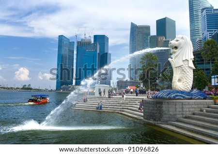 SINGAPORE-AUG.21 The Merlion fountain and Singapore skyline on Aug 21 2011 Merlion is a mythical creature with the head of a lion and the body of a fish and is seen as a symbol of Singapore