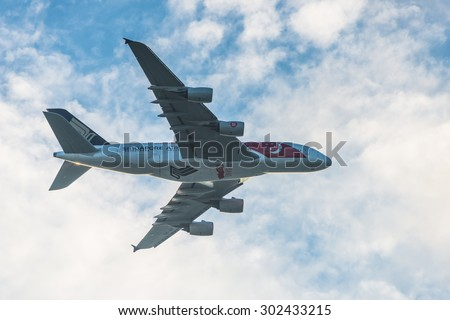 Singapore - August 01, 2015: Singapore 50years National Day Singapore Airlines Airbus A380 flew over the city