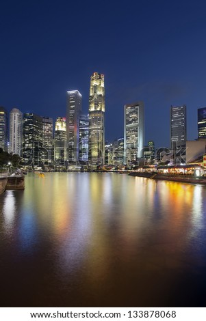 Singapore Central Business District (CBD) City Skyline by Boat Quay Along Singapore River at Blue Hour Vertical