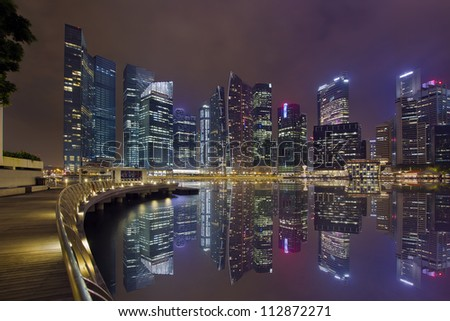 Singapore Central Business District City Skyline Along Marina Bay Boardwalk at Night