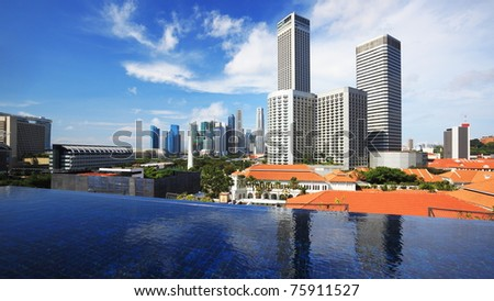 Singapore city buildings, view from a rooftop infinity pool