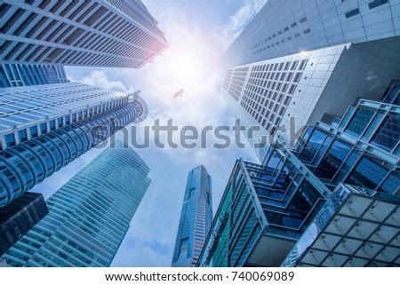 Singapore city business center financial . Panoramic and perspective view light blue background of glass high rise building skyscraper commercial of future. Business  #740069089