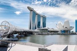 Singapore city landscape at day blue sky. Pedestrian DNA bridge at Marina Bay view. Urban cityscape