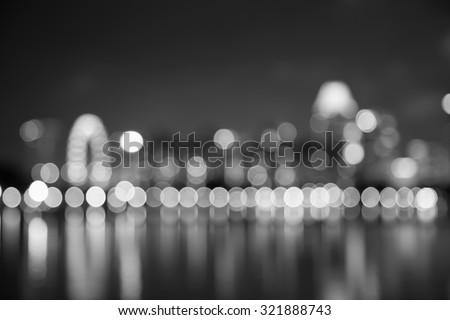 Singapore city night lights bokeh and reflect of marina bay blurred black and white background