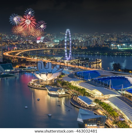 Singapore city skyline aerial with firework view during twilight time in Singapore National day