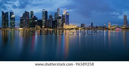 Singapore City Skyline along Singapore River Panorama at Blue Hour