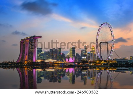 Singapore city skyline and Singapore Flyer at Marina Bay cityscape by night #246900382