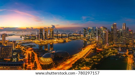 Singapore city with office building, hotel and harbor in morning sunrise time. Singapore city  #780297157