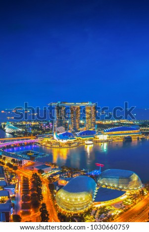 Singapore cityscape at dusk. Landscape of Singapore business building around Marina bay. Modern high building in business district area at twilight.  #1030660759