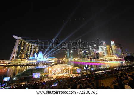 SINGAPORE -DEC 31: Countdown 2012 with beams of light and fireworks at Marina Bay December 27 ,2011 in Singapore.