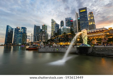 SINGAPORE-DEC 03, 2014: Merlion statue fountain in Merlion Park and Singapore city skyline on December 03, 2014. This fountain is one of most well known icons of Singapore #593613449