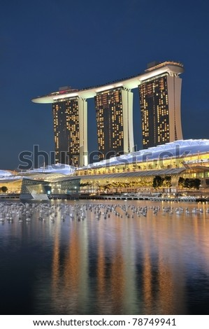 SINGAPORE - DEC 31: Night view of the Marina Bay Sands resort hotels on Dec 31, 2010 in Singapore. Developed by Las Vegas Sands, it is billed as the world's most expensive casino.