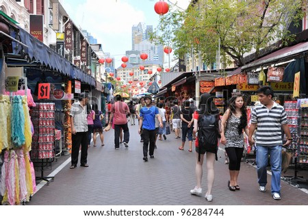SINGAPORE - FEB 11: Shoppers walk through Chinatown as Singapore welcomes in Chinese New Year on Feb 11, 2012 in Singapore. The city state's ethnic Chinese began settling in Chinatown circa 1820s.