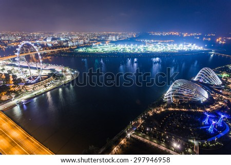 SINGAPORE - FEBRUARY 27, 2015: aerial view of Garden by the Bay and Singapore Flyer at night. Garden by the Bay and Singapore Flyer are the famous tourist attraction in Singapore.