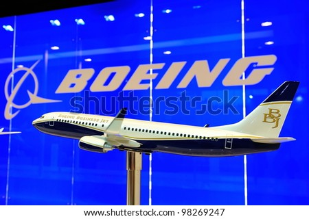 SINGAPORE - FEBRUARY 17: Boeing 737 business executive jet model plane on display at Singapore Airshow February 17, 2012 in Singapore