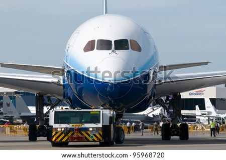 SINGAPORE - FEBRUARY 14: Boeing 787 Dreamliner being towed at Singapore Airshow in Singapore on February 14, 2012.