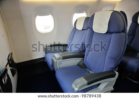 SINGAPORE - FEBRUARY 17: Business class cabin of a China Southern Airlines Embraer 190 aircraft at Singapore Airshow February 17, 2012 in Singapore