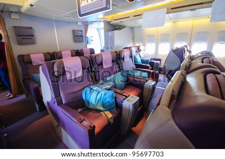 SINGAPORE - FEBRUARY 12: Business class seats in Singapore Airlines' (SIA) last Boeing 747-400 aircraft at Singapore Airshow February 12, 2012 in Singapore