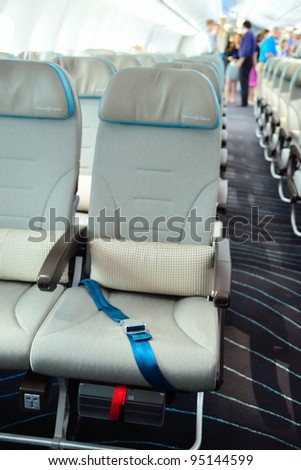 SINGAPORE - FEBRUARY 12: Close-up of an Economy class seat in a Boeing 787 Dreamliner at Singapore Airshow February 12, 2012 in Singapore