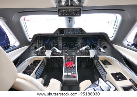 SINGAPORE - FEBRUARY 12: Cockpit of a Embraer Phenom 300 business jet at Singapore Airshow February 12, 2012 in Singapore