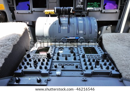 SINGAPORE - FEBRUARY 03: Cockpit of a private jet at Singapore Airshow February 03, 2010 in Singapore - stock photo