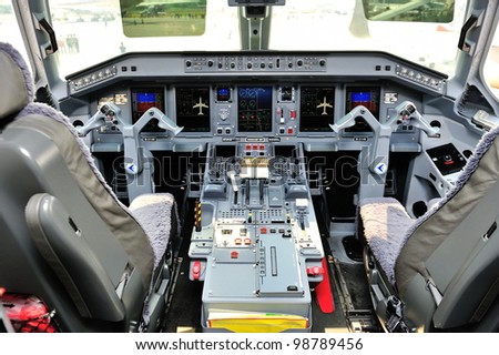 SINGAPORE - FEBRUARY 17: Cockpit of Embraer 190 aircraft at Singapore Airshow February 17, 2012 in Singapore