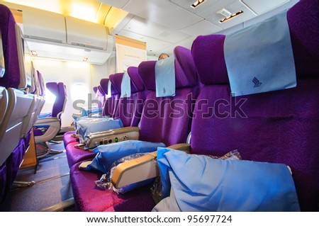 SINGAPORE - FEBRUARY 12: Economy class cabin in Singapore Airlines' (SIA) last Boeing 747-400 aircraft at Singapore Airshow February 12, 2012 in Singapore