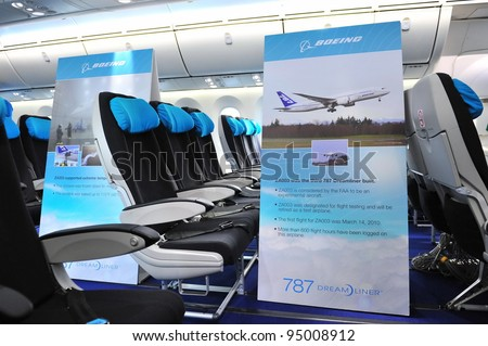 SINGAPORE - FEBRUARY 12: Economy class in Boeing 787 Dreamliner at Singapore Airshow February 12, 2012 in Singapore