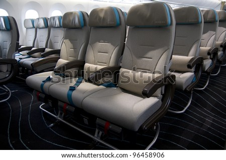 SINGAPORE - FEBRUARY 15: Economy class seats onboard a Boeing 787 Dreamliner on display at Singapore Airshow in Singapore on February 15, 2012.
