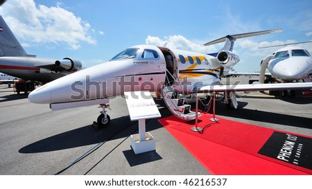 SINGAPORE - FEBRUARY 03: Embraer Phenom 100 business jet on display at Singapore Airshow February 03, 2010 in Singapore