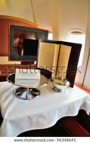 SINGAPORE - FEBRUARY 17: First class cabin cavier bowl and cake tray in Singapore Airlines' (SIA) last Boeing 747-400 aircraft at Singapore Airshow on February 17, 2012 in Singapore
