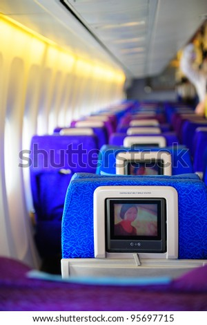 SINGAPORE - FEBRUARY 12: Inflight entertainment system in economy class cabin in Singapore Airlines' (SIA) last Boeing 747-400 aircraft at Singapore Airshow February 12, 2012 in Singapore