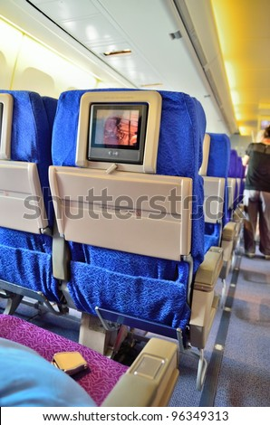 SINGAPORE - FEBRUARY 17: Inflight entertainment system in economy class cabin in Singapore Airlines' (SIA) last Boeing 747-400 aircraft at Singapore Airshow on February 17, 2012 in Singapore