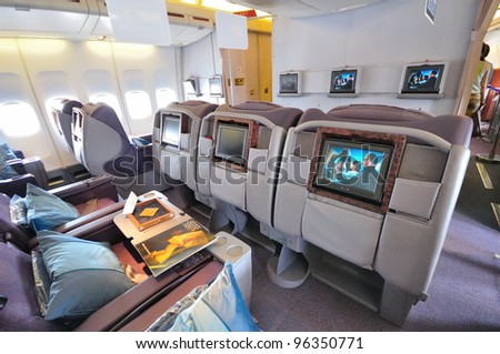 SINGAPORE - FEBRUARY 17: Inflight entertainment system of business class cabin in Singapore Airlines' (SIA) last Boeing 747-400 aircraft at Singapore Airshow on February 17, 2012 in Singapore