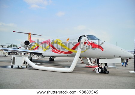 Singapore  February 17 Jackie Chan39S Private Jet Legacy 650 On Displa