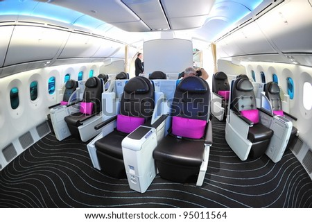 SINGAPORE - FEBRUARY 12: Luxurious and spacious business class seats in a Boeing 787 Dreamliner at Singapore Airshow February 12, 2012 in Singapore