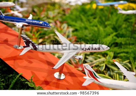 SINGAPORE - FEBRUARY 17: Model of Qatar passenger carrier on display at Singapore Airshow on February 17, 2012 in Singapore