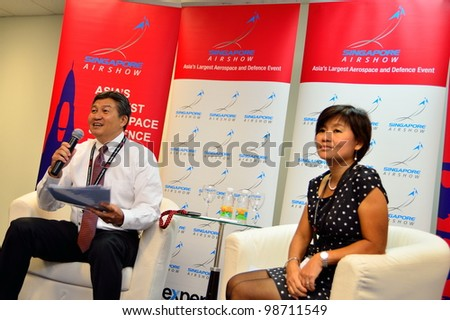 SINGAPORE - FEBRUARY 17: Mr Jimmy Lau, Managing Director of Experia Events and Ms Angelica Lim (General Manager) speaking at the media briefing at Singapore Airshow February 17, 2012 in Singapore